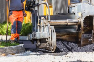 Worker and Asphalt Machine