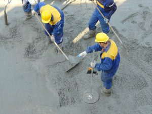 Concrete Workers Spreading New Concrete